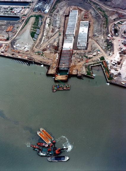 June 1994 Backhoe Dredger Loading Silt into Barges in Mid-River