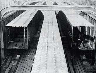 January 1968 Sections of the twin box girders (total 412 tons) in position after erection between the wrought iron girders of the old railway bridge.