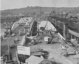 October 1969 View of the new road bridge and its approaches from the Rochester side showing the completed bridge deck in relation to the existing road and rail bridges.