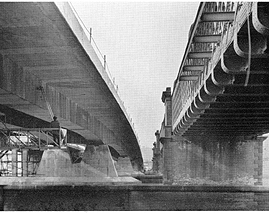 October 1969 The downstream underside of the completed bridge deck with the painting cradle attached. The cradle travels the whole length of the steel girders, rotating 90 degrees to pass through the piers.
