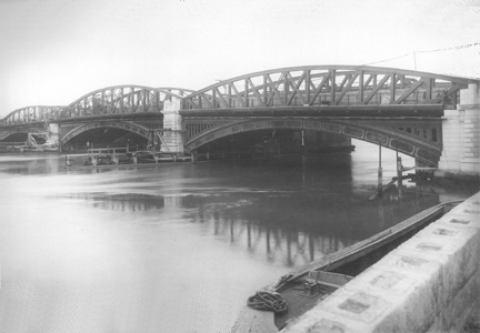 Reconstructed Bridge showing Steel Arches Above the Roadway and Cast Iron Arches Below.