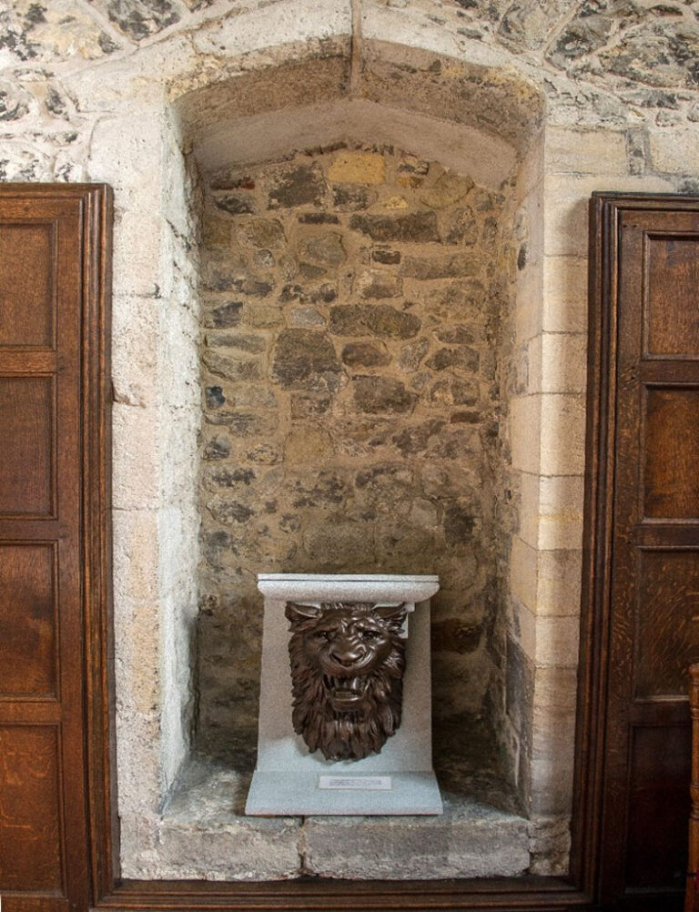 The aumbry, this is a closed cupboard found in wall recesses in churches, used to store candles, wine etc for Mass.