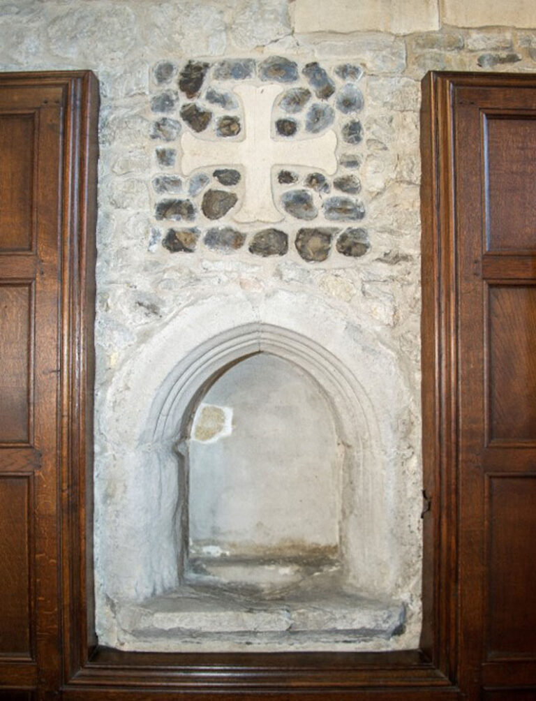 The chapel has two piscinas which would have held holy water and was also used for pouring away water after use. Note the photograph of one of the piscinas in 1928.